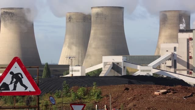 Panning Shot steam rises from the RatcliffeonSoar coal fired power station on October 17 2013 in Nottinghamshire England