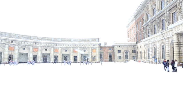 panning shot: Stockholm palace with heavy winter snow Sweden