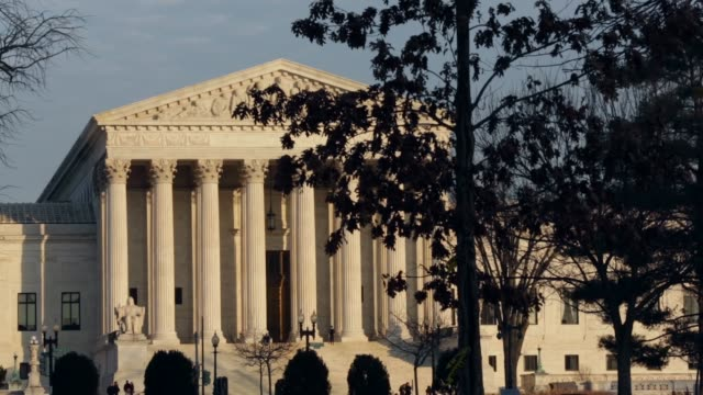 panning shot the exterior view of the us supreme court washington dc february 7 2014 - oberstes bundesgericht der usa stock-videos und b-roll-filmmaterial