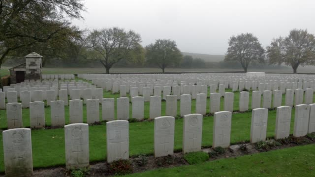 Panning Shot The grave at Gordon Dump Cemetery of Donald Bell VC who was killed aged 25 on the Somme in WW1 Bell was the first professional...