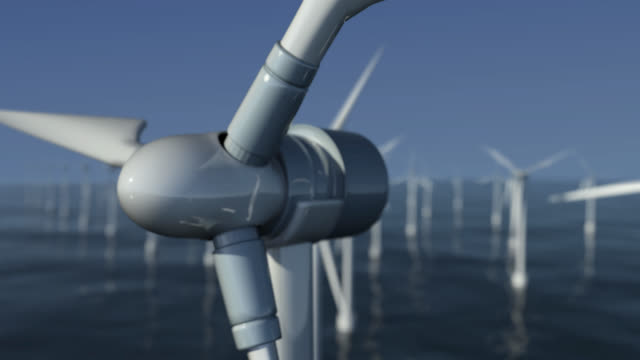 panning shot to close-up of wind turbines at sea - turbine stock videos & royalty-free footage
