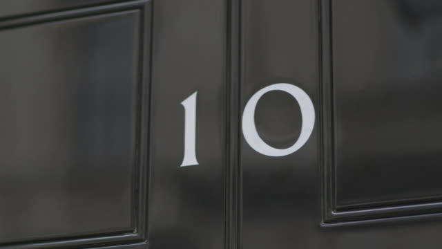 panning shot to the door number of ten downing street. - 10 downing street stock videos and b-roll footage