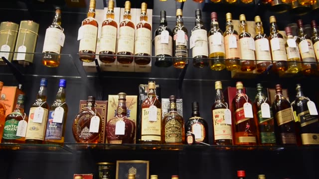 panning shot, whiskey collection going on auction. whiskey collectors as far afield as the united states, china and australia will be looking in on... - scotch whiskey stock videos & royalty-free footage
