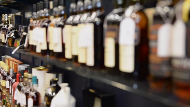 panning shot whiskey collection whiskey collectors as far afield as the united states china and australia will be looking in on the auction as some... - versteigerung stock-videos und b-roll-filmmaterial