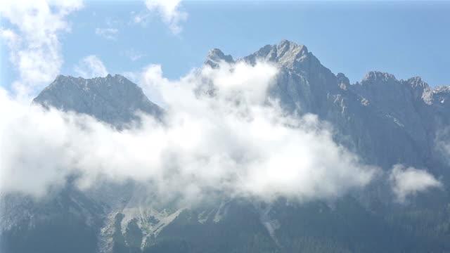panning shot: zugspitze alpine alps mountain range landscape top of germany - garmisch partenkirchen stock videos & royalty-free footage