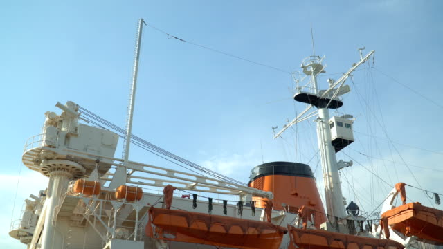 panning side view: Radar yach and net and  Lifeboat on a old ice-breaker