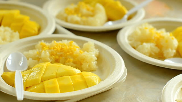 panning : slice mango into sticky rice in paper plate - paper plate stock videos & royalty-free footage