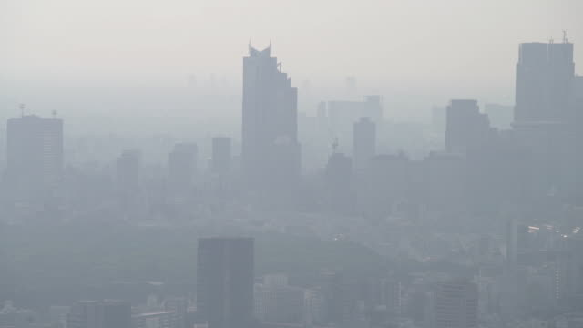 panning slow motion of tokyo city - air pollution stock videos & royalty-free footage
