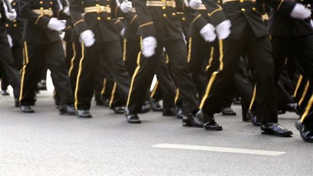 hd panning: soldiers marching in the streets. - marching stock videos & royalty-free footage