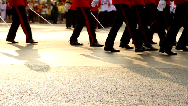 hd panning: soldiers marching in the streets. - marching stock videos and b-roll footage