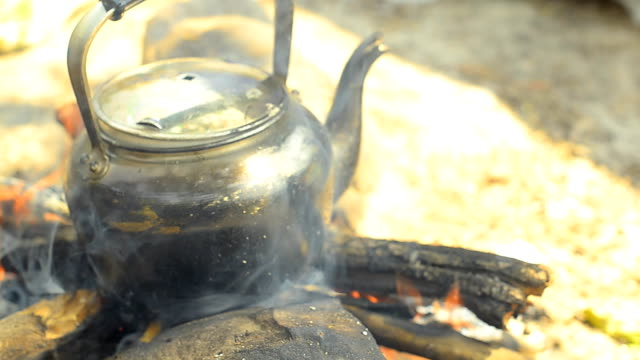 panning: steaming tea kettle  by traditional method - tea kettle stock videos & royalty-free footage