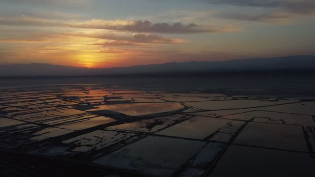 panning sunrise drone video of yuncheng salt lake in north china's shanxi province. footage by: costfoto / barcroft studios via getty images - gold colored stock videos & royalty-free footage