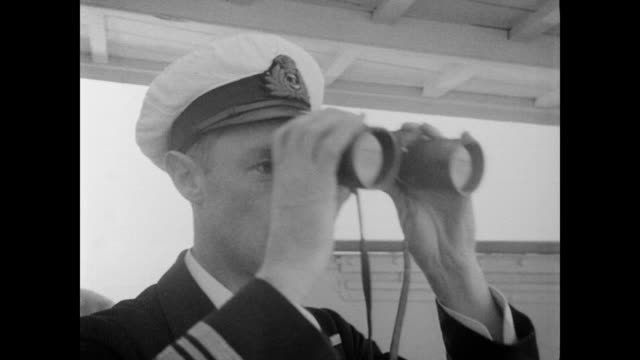 / panning the shoreline of the yangtze river / plane flies overhead / captain and crew watch plane / orders given to crew inside ship's command... - 1937 stock videos & royalty-free footage