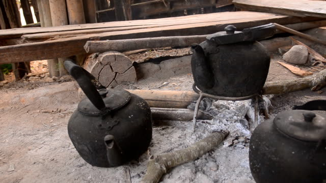 panning: three steaming tea kettle  by traditional method - tea kettle stock videos & royalty-free footage