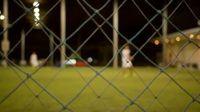 panning through nets: play soccer - indoor soccer stock videos & royalty-free footage