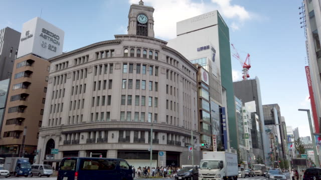 4k panning tilt up ginza wako in tokyo , japan . - ginza stock videos & royalty-free footage