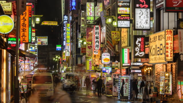 4k panning time lapse : crowd on kabukicho at night, tokyo , japan - party host stock videos & royalty-free footage