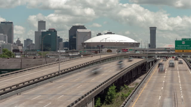 panning time lapse daytime afternoon cloudy day pontchartrain expressway, new orleans, la. with skyline and mercedes-benz superdome. - mercedes benz stock videos and b-roll footage