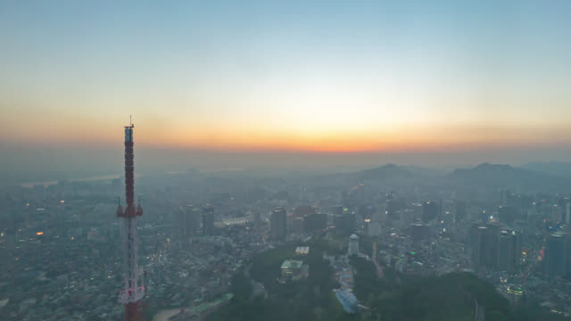 panning time lapse of day to night sunset over seoul city - air pollution stock videos & royalty-free footage