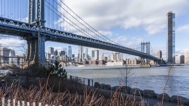 panning time lapse of manhattan bridge and east river - new york - east river stock videos & royalty-free footage