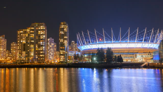 panning time lapse shot of illuminated bc place by sea against sky at night - vancouver, canada - vancouver canada stock videos & royalty-free footage
