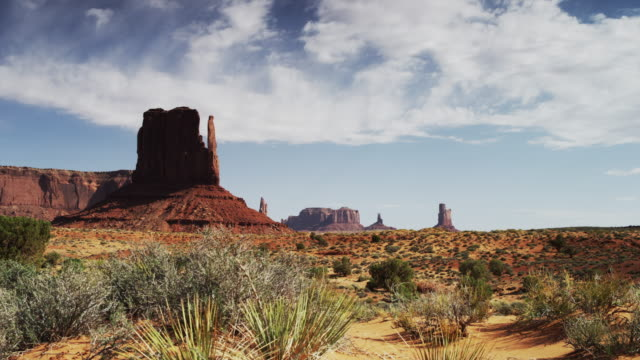 panning time lapse shot of rock formations in monument valley / monument valley, utah, united states,  - monument valley stock videos & royalty-free footage