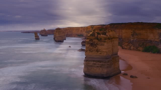 panning time-lapse of the twelve apostles on a stormy day - remote location stock videos & royalty-free footage