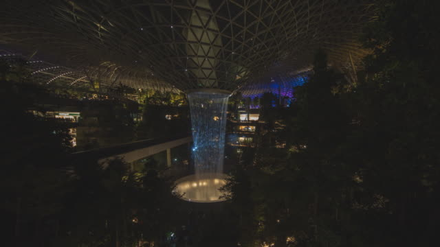 4k panning timelapse wide angle view light show of giant waterfall in jewel, changi airport at night from start to the end, singapore - jewel stock videos and b-roll footage
