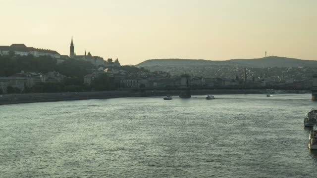 panning tl: city view around danube river that consisted of castle hill from elisabeth bridge on sunset in budapest, hungary - royal palace of buda stock videos & royalty-free footage