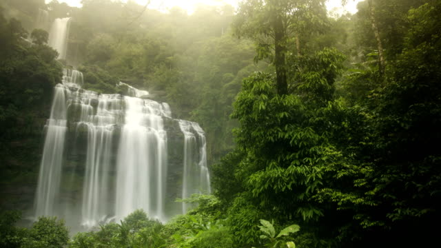 panning tl: tad kameud waterfall under sunset - flowing water stock videos & royalty-free footage
