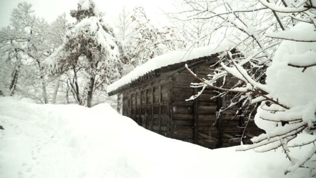 panning to see olde wooden house beside the street at shirakawago village under snow - roof stock videos & royalty-free footage