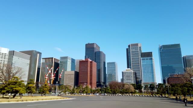 panning tokyo cityscape in tokyo , japan - marunouchi stock videos & royalty-free footage
