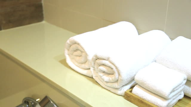 hd panning: towels in bathroom - towel stock videos and b-roll footage