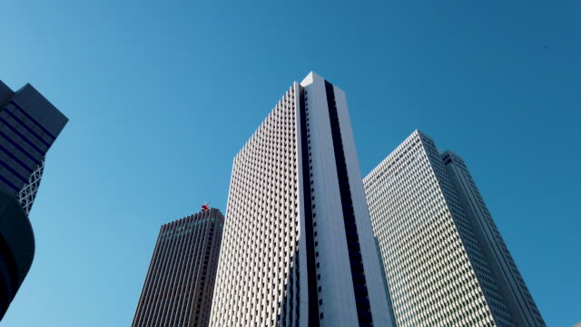 panning tracking shot . tokyo cityscape office background - office building exterior stock videos & royalty-free footage