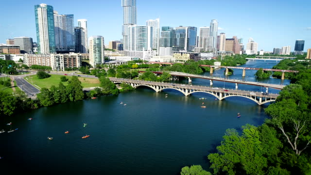 panning up from kayakers and bridges to the austin texas 2019 skyline cityscape with the tallest building and no cranes - austin texas stock videos & royalty-free footage