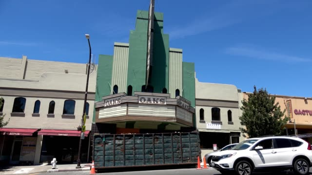 panning up from solano avenue to the marquee of the historic oaks theatre in the thousand oaks neighborhood of berkeley, california, 2018. - theatre banner commercial sign stock videos & royalty-free footage