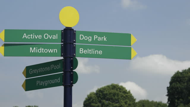 panning up to directional signs - directional sign stock videos & royalty-free footage