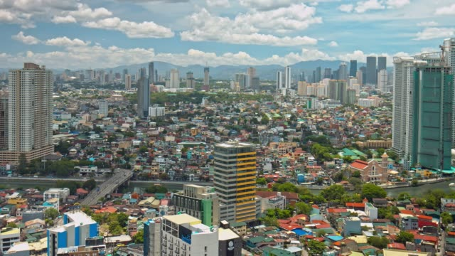 panning video in manila makati on a sunny day, philippines - philippines stock videos and b-roll footage