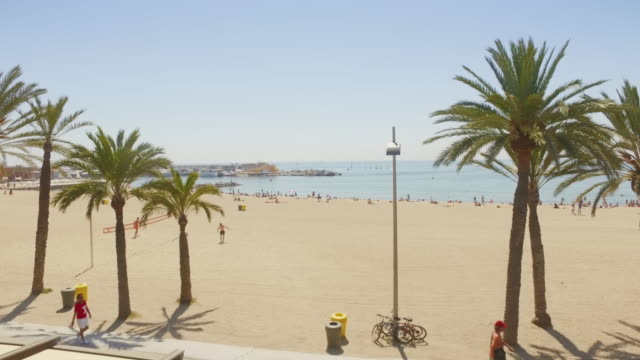 Panning video of Barceloneta beach in Barcelona, Spain