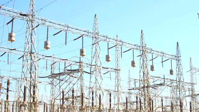 Panning video of electric grids and towers in a electric power station