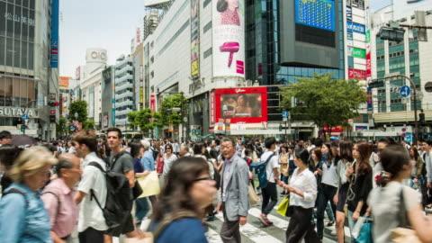 panning video of shibuya crossing in tokyo - shibuya ward stock videos & royalty-free footage