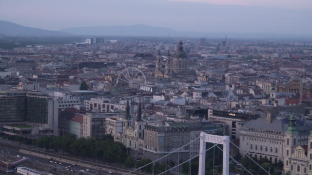 panning view: cityscape of budapest at dust from gellért hill - traditionally hungarian stock videos & royalty-free footage