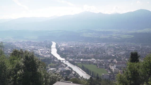 panning view: innsbruck city form hafelekarspitze-seegrube at karwendel mountain,innsbruck austria in  evening summer - tyrol state austria stock videos and b-roll footage