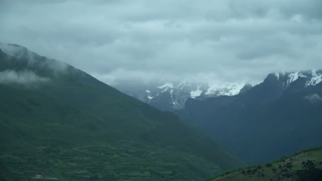 panning view: mount siguniang under rainy cloud from in changping gou valley or changping valley, china - high up stock videos & royalty-free footage