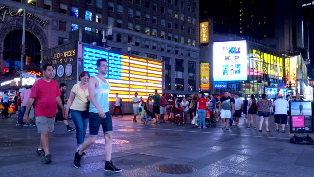panning view of american flag in times square, new york city - electronic billboard stock videos and b-roll footage