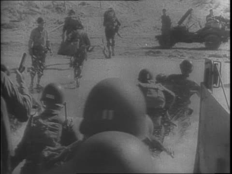 panning view of bombed buildings on pantelleria / various angles of allied troops marching through a bombed out city / landing ship arriving in... - allied forces stock videos and b-roll footage