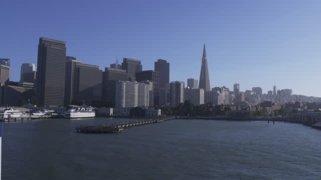 panning view of city skyline an pier across the water - san francisco bay stock videos & royalty-free footage