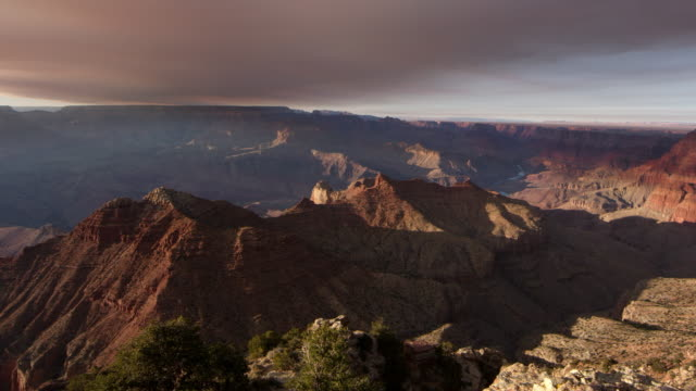 panning view of cliffs lit up from the south rim of the grand canyon - grand canyon stock videos & royalty-free footage