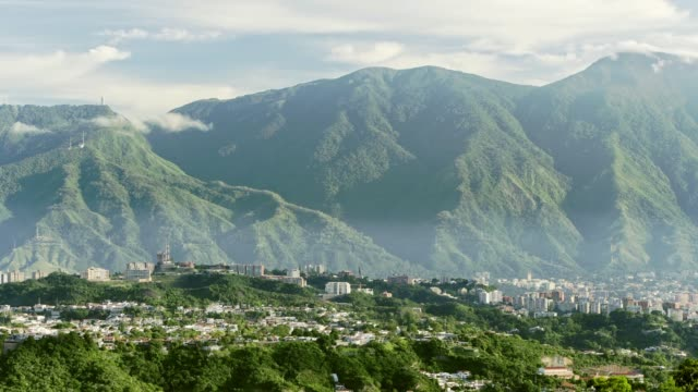 panning view of eastern district in caracas city valley at early morning with el avila at the background - caracas stock videos & royalty-free footage
