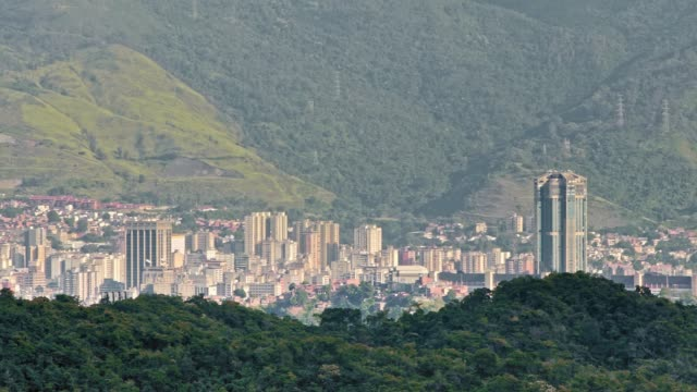 panning view of eastern district in caracas city valley at early morning with el avila at the background - venezuela stock videos & royalty-free footage